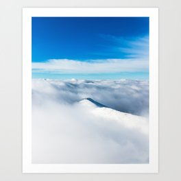 Snowy winter mountain wrapped in clouds Art Print