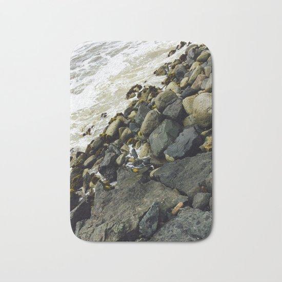 Rocks from a dock Bath Mat