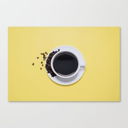 Black Cup of Coffee with Coffee Beans on Yellow Canvas Print