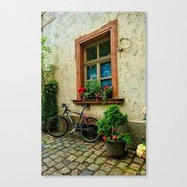 Scene on a German cobblestone alley Canvas Print