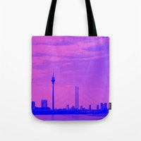 cityscape Tote Bags featuring Cityscape by DuniStudioDesign