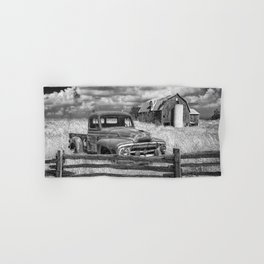 Black and White of Rusted International Harvester Pickup Truck behind wooden fence with Red Barn in Hand & Bath Towel