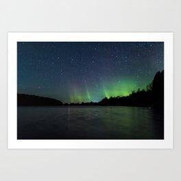Northern Lights above a lake Art Print