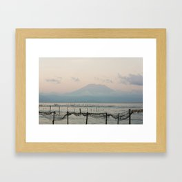 Seaweed fields and Bali in the mist Framed Art Print