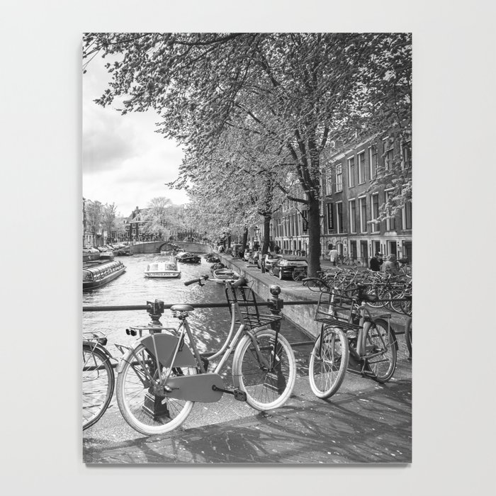 Bicycles parked on bridge over Amsterdam canal Notebook