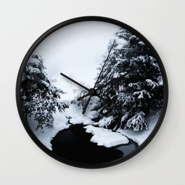 Snowy pond and trees disappearing in fog Wall Clock