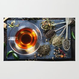 Tea composition with old spoon on dark background Rug