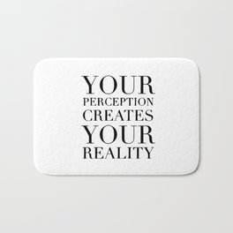 Your perception creates your reality Bath Mat