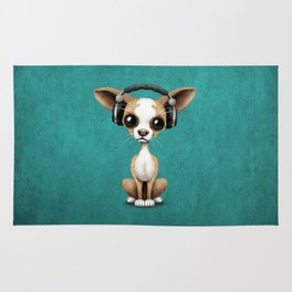 Cute Chihuahua Puppy Dog Wearing Headphones on Blue Rug
