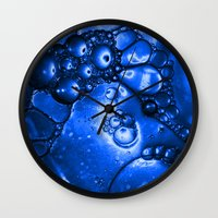 titan Wall Clocks featuring Titan by Brian Raggatt