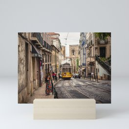 Tram 28 transports tourists through Alfama district in Lisbon, Portugal Mini Art Print