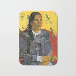 Tahitian Woman with a Flower by Paul Gauguin Bath Mat