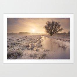 Sunrise over a frozen landscape in The Netherlands Art Print