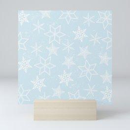 Snowflakes on light blue background Mini Art Print