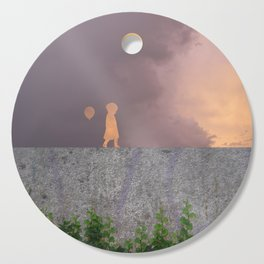 Sunset with girl walking on a wall followed by a balloon Cutting Board