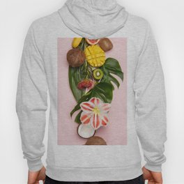 Creative flat lay with tropical fruits and plants on pink background Hoody