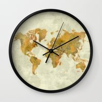 vintage map Wall Clocks featuring  World Map Yellow Vintage by City Art Posters