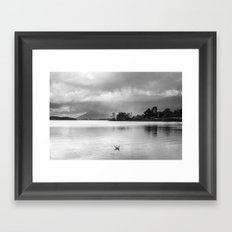 Evening rainclouds, bird and distant rain over Skiddaw and Derwent Water. Lake District, UK. Framed Art Print
