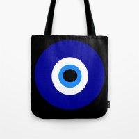 evil eye Tote Bags featuring Evil Eye by GeekyPhilosopher