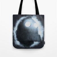 iron giant Tote Bags featuring The Iron Giant Rises by Chuck Jackson