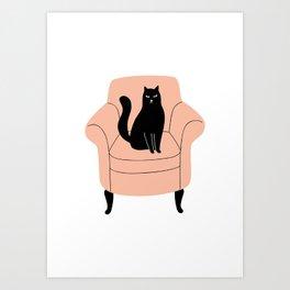black cat on a chair Art Print