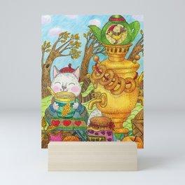 White cute cat drinks tea from a samovar on an autumn day. Mini Art Print