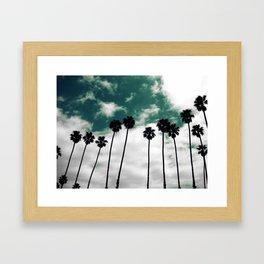 Palms in the sky Framed Art Print