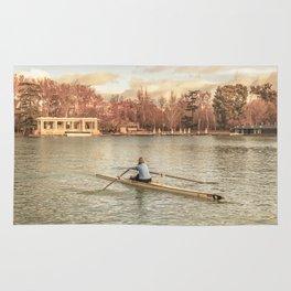 Woman Rowing at Del Retiro Park, Madrid, Spain Rug