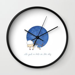 it's just a hole in the sky Wall Clock