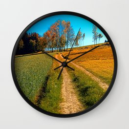 Hiking trail following the trees Wall Clock