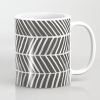 herringbone Mugs featuring Herringbone – Black & White by Cat Coquillette