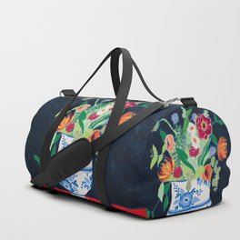 Bouquet of Flowers in Blue and White Urn on Navy Duffle Bag