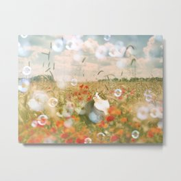 Cat looking up at bubbles in flower field Metal Print