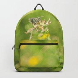Little butterfly in flowery meadow Backpack