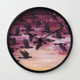 red-winged blackbird flock in flight Wall Clock