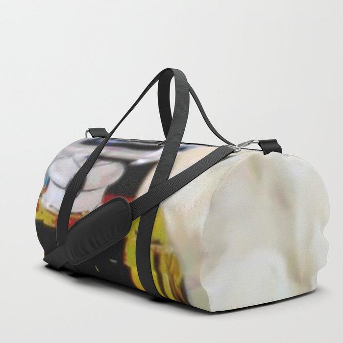 Edgy Take on a Fashion Icon Duffle Bag