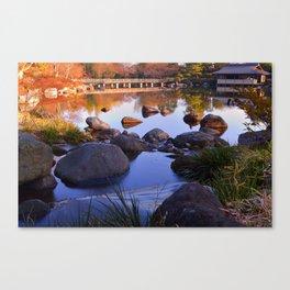 Hut and Bridge on Pond Canvas Print