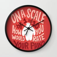 risa rodil Wall Clocks featuring Rate your pain by Risa Rodil