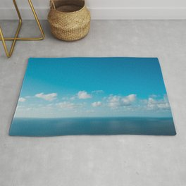 blue sky above ocean panorama with white clouds Rug