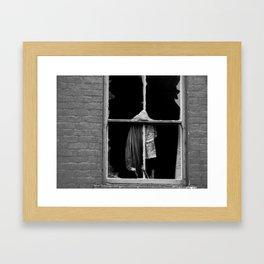 a broken window Framed Art Print