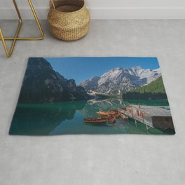 The Seekofel mountains and wooden boats reflected in the waters of Lake Braies Rug