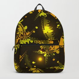 Glowing pattern of delicate leaves and petals of garden plants in autumn yellow tones. Backpack