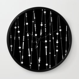 . Pearl beads on a black background Wall Clock