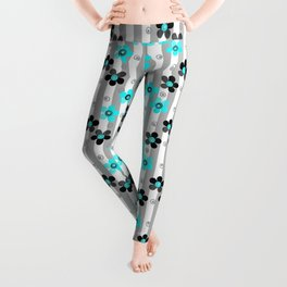 Black and turquoise floral pattern . Leggings
