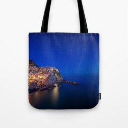 As the night falls over Manarola Tote Bag