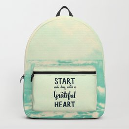 Start each day with a grateful heart Text on sea photo Backpack