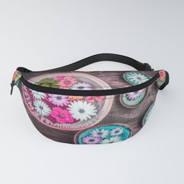 Beautiful floral composition with colorful flowers floating in water on dark wooden table. Fanny Pack