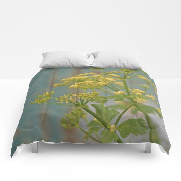 Yellow wildflowers on blue rusty metal Comforters