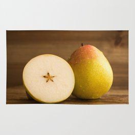 One pear and a half on rustic wood against rustic wooden background close front view Rug