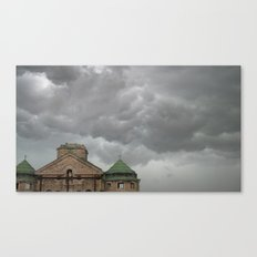 Church remains in a stormy sky. Canvas Print